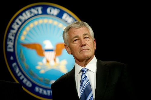 Defense Secretary Chuck Hagel stand during the playing of the service melodies after a welcoming and swearing in ceremony at the Pentagon, March 14, 2013. (DoD photo by Mass Communication Specialist 1st Class Chad J. McNeeley/Released)