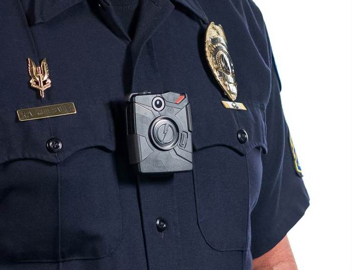 One of Taser's Axon cameras, worn on the shirt; other models fit on sunglasses or hat brims.