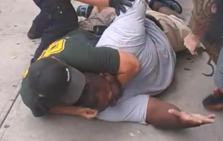 Eric Garner killed by a cop using an illegal choke hold.